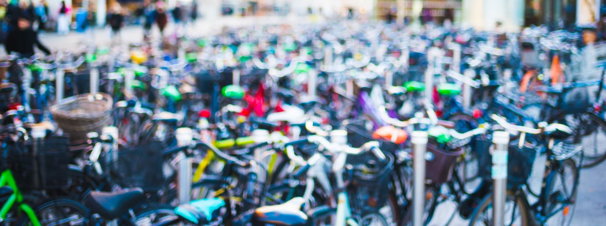 Intentionally blurred view of a lot of bicycles