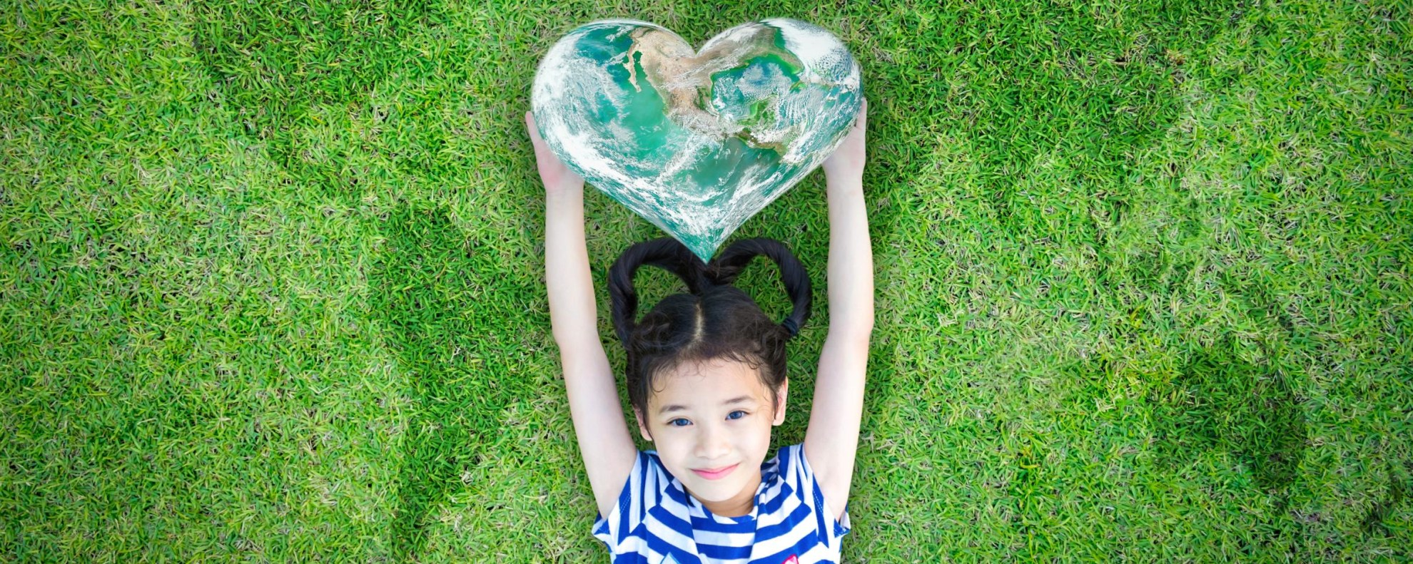Little girl with earth heart