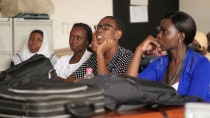 Radiology residents from MUHAS closely follow a diagnostic radiology lecture. Shown from left to right are Drs. Hasna Nuhu, Ndigwake Mallango, Helena Mchibya, and Roselyne Okello
