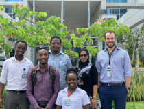 Tanzanian and US IR residents in front of the MNH Mloganzila campus. From left to right: Drs. Ivan Rukundo, Ziad Byekwaso, Erick Mbuguje, Mwivano Shemwetta, Azza Naif, and Fabian Laage Gaupp.