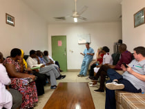Dr. David Prologo from Emory giving a morning lecture to Tanzanian IR residents before starting procedures.
