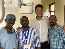 Residents, technologists and medical students working together in IR: Dr. Ivan Rukundo, Basilio Fabian Maha, Jonathan Apasu, and Joseph Kulinga.