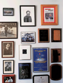 Displayed in the middle of Janeway's office wall are photographs of four generations of Janeway doctors.