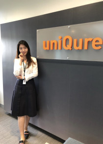Jing stand by the uniQure sign