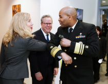 U.S. Surgeon General Jerome Adams elbow bumps to reduce the possibility of inadvertently spreading disease.