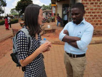NGN member Dr. Evelyn Hsieh, talking with Dr. Richard Munana, a doctor at ACCESS, outside Nakaseke Hospital.