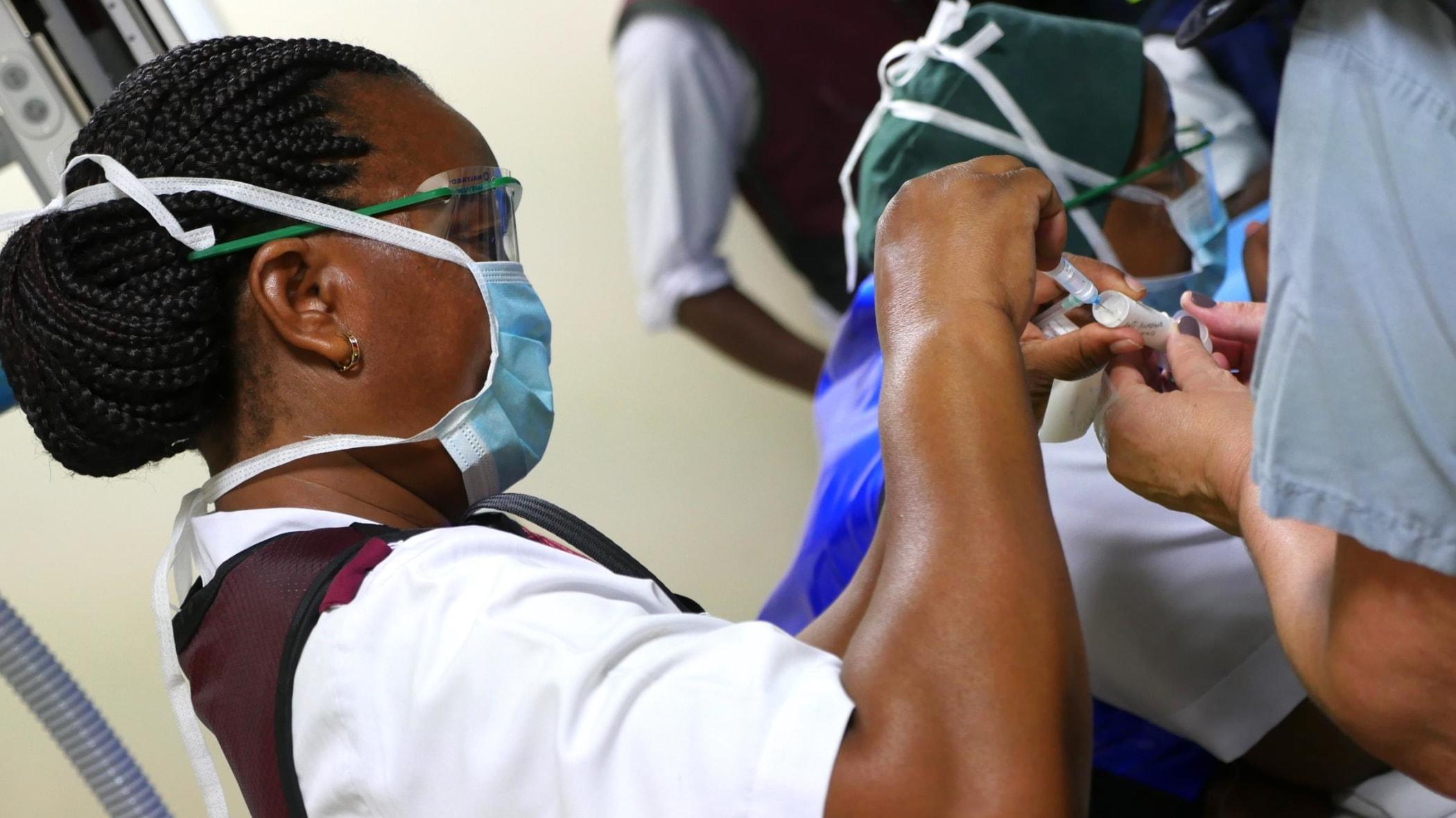 Tanzanian IR nurse Bridgita Fwaja drawing up medications for a procedure.