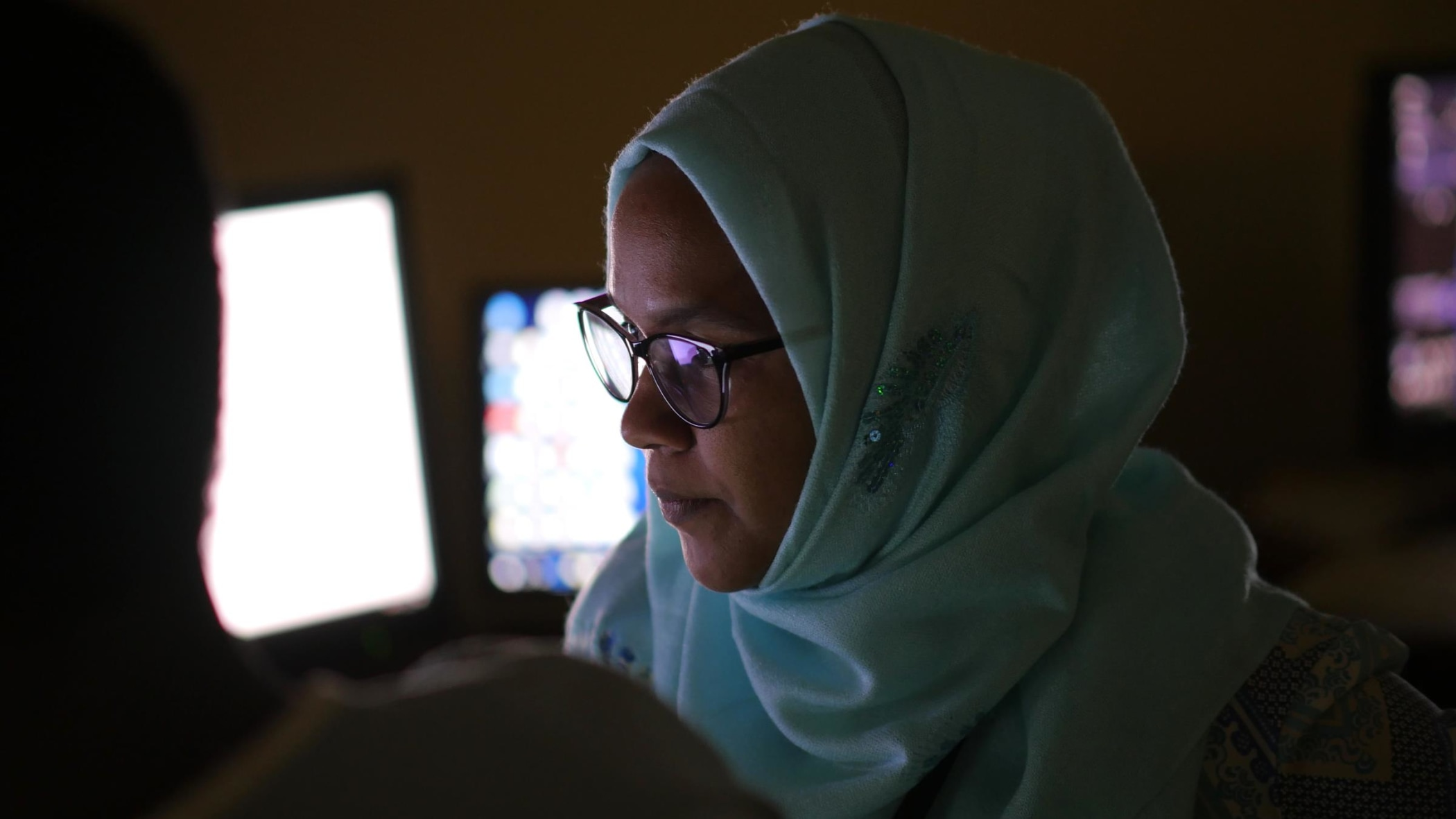 Dr. Azza Naif reviewing imaging before an IR procedure.