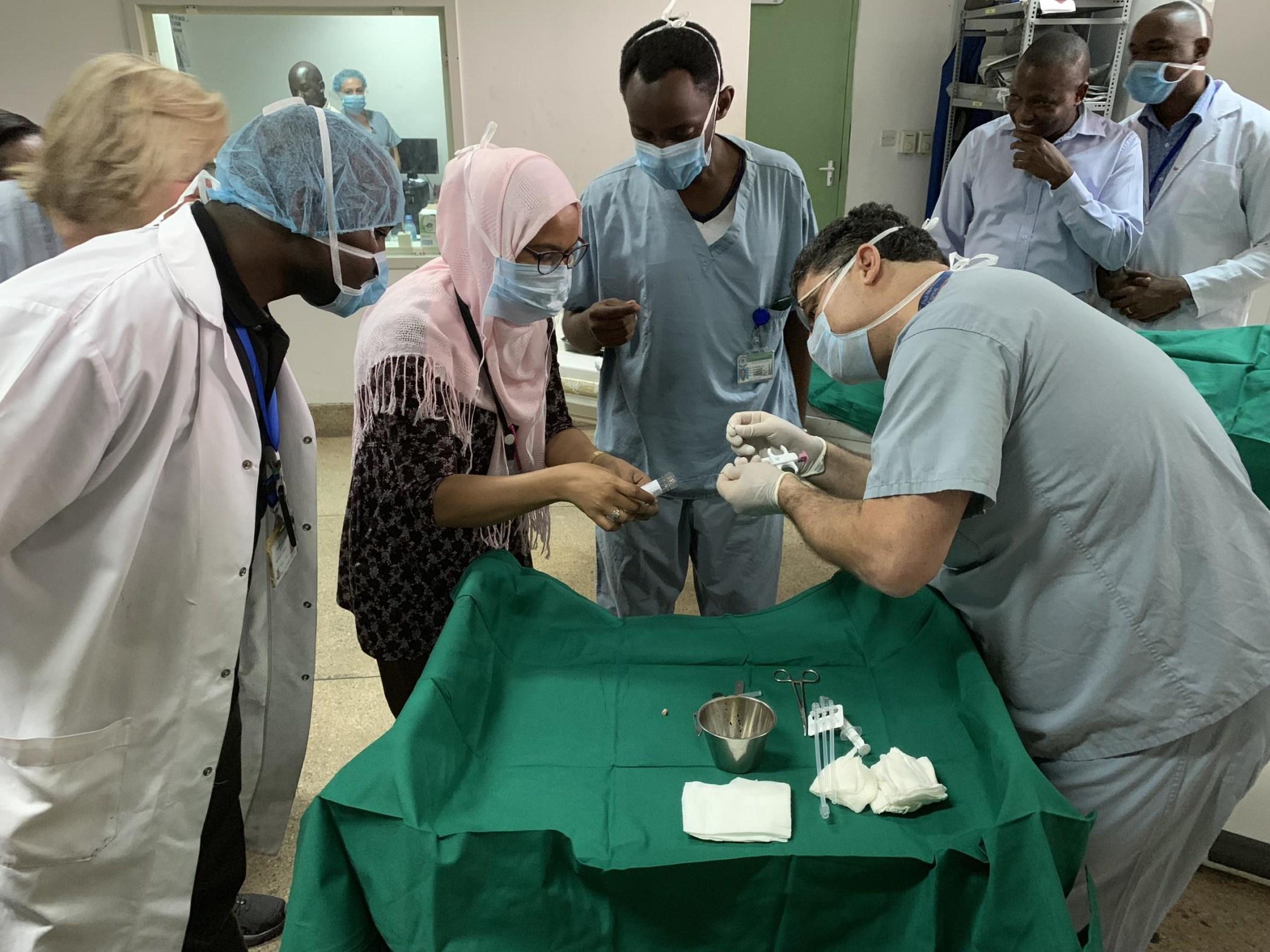 Drs. Douglas Silin and Azza Naif securing a core needle biopsy specimen.