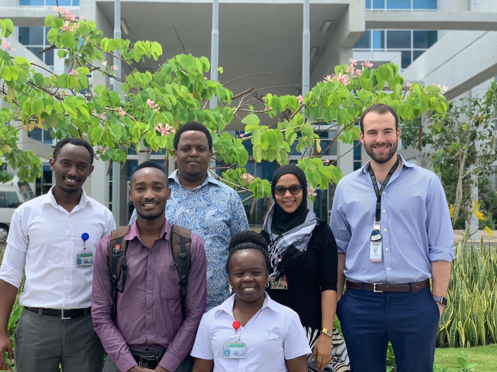 Tanzanian and US IR residents in front of the MNH Mloganzila campus. From left to right: Drs. Ivan Rukundo, Ziad Byekwaso, Erick Mbuguje, Mwivano Shemwetta, Azza Naif, and Fabian Laage Gaupp.