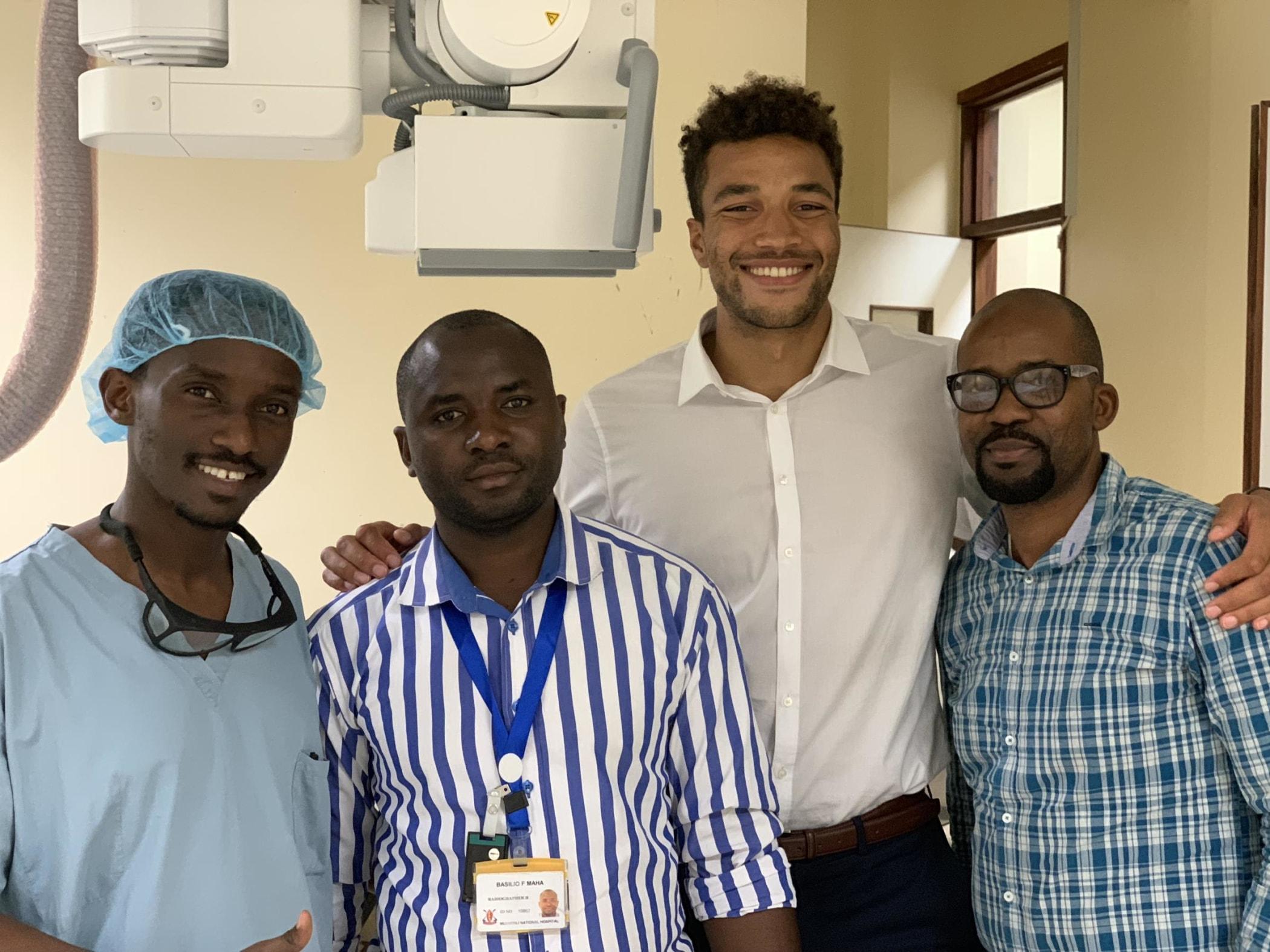 Residents, technologists and medical students working together in IR: Dr. Ivan Rukundo, Basilio Fabian Maha, Jonathan Apasu, and Joseph Kulinga.