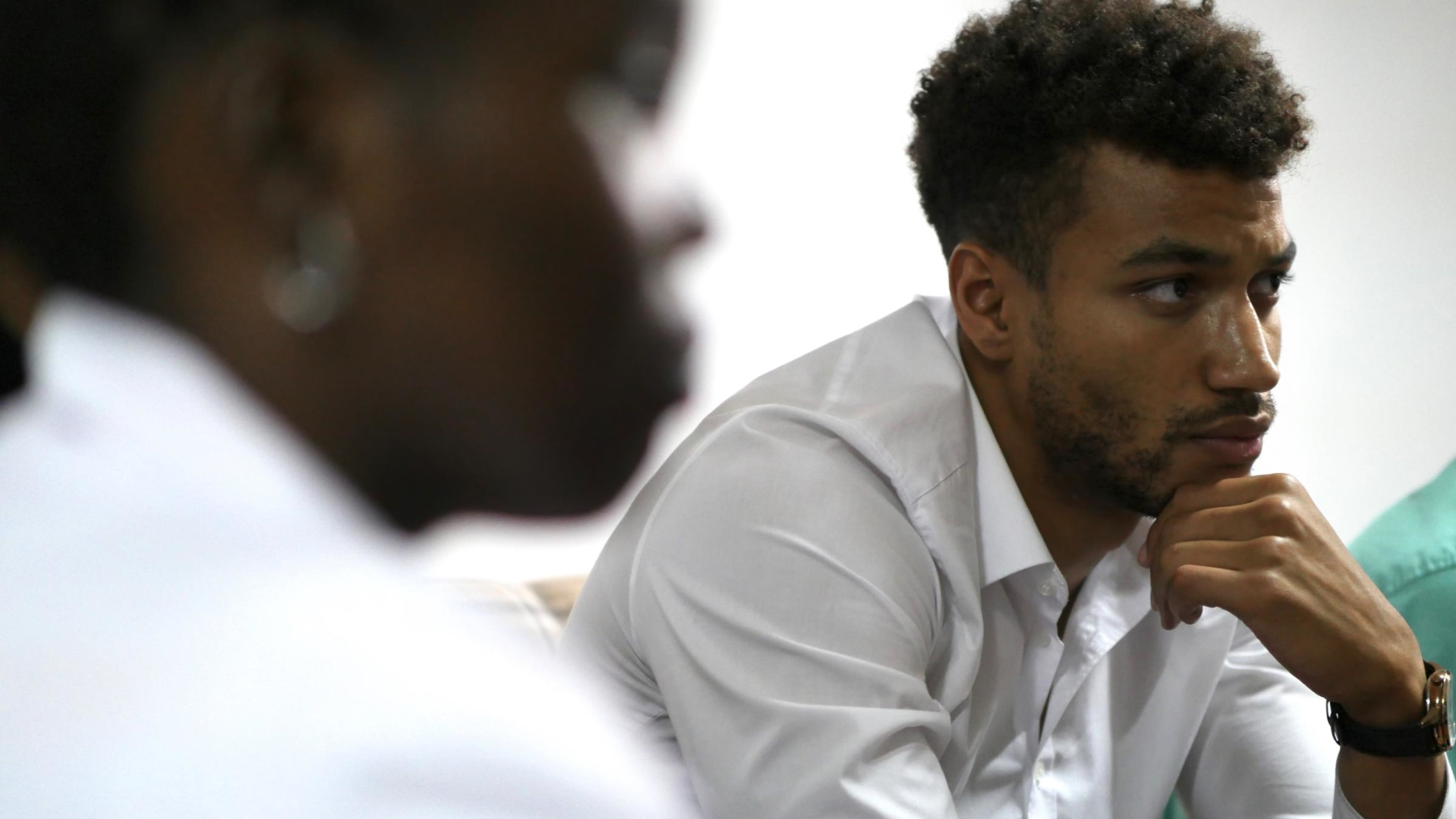 Jonathan Apasu, a visiting medical student from Germany, listening during a group discussion.