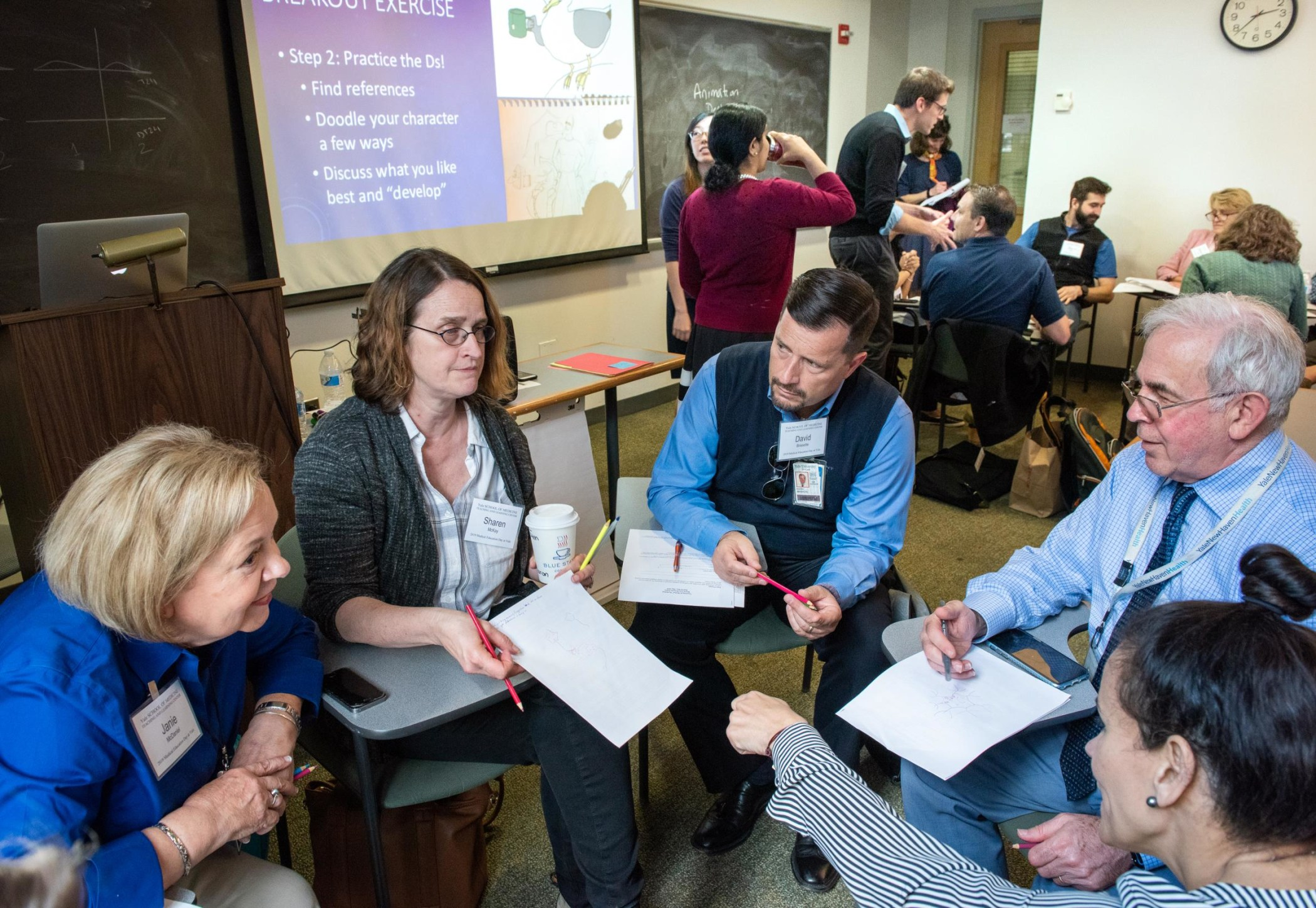 Workshop participants conversing during a small-group discussion