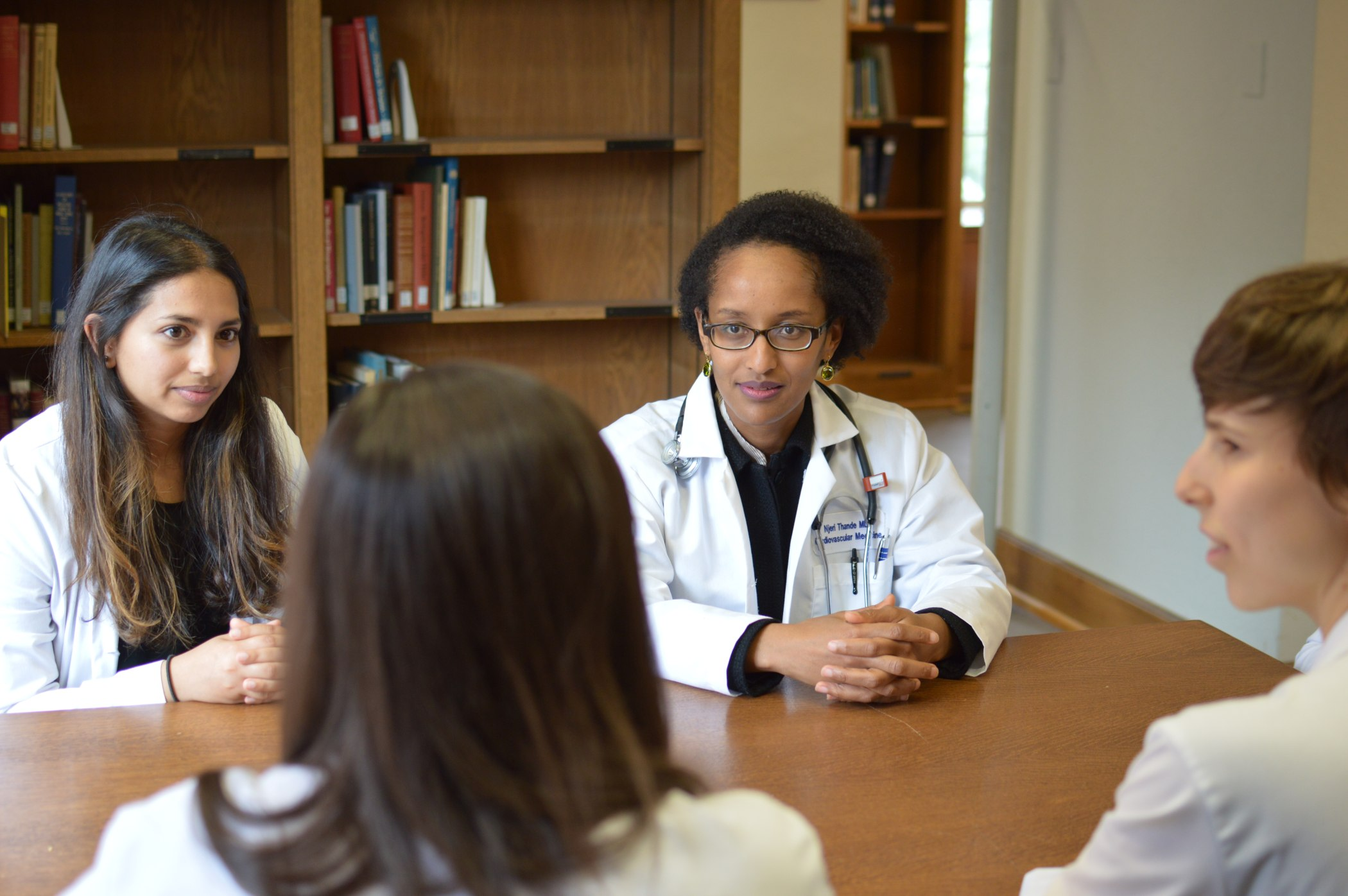 Dr. Njeri Thande (right) is working with WHRY and students such as Nisha Dalvie (left) to integrate a focus on sex and gender into the Yale School of Medicine curriculum.