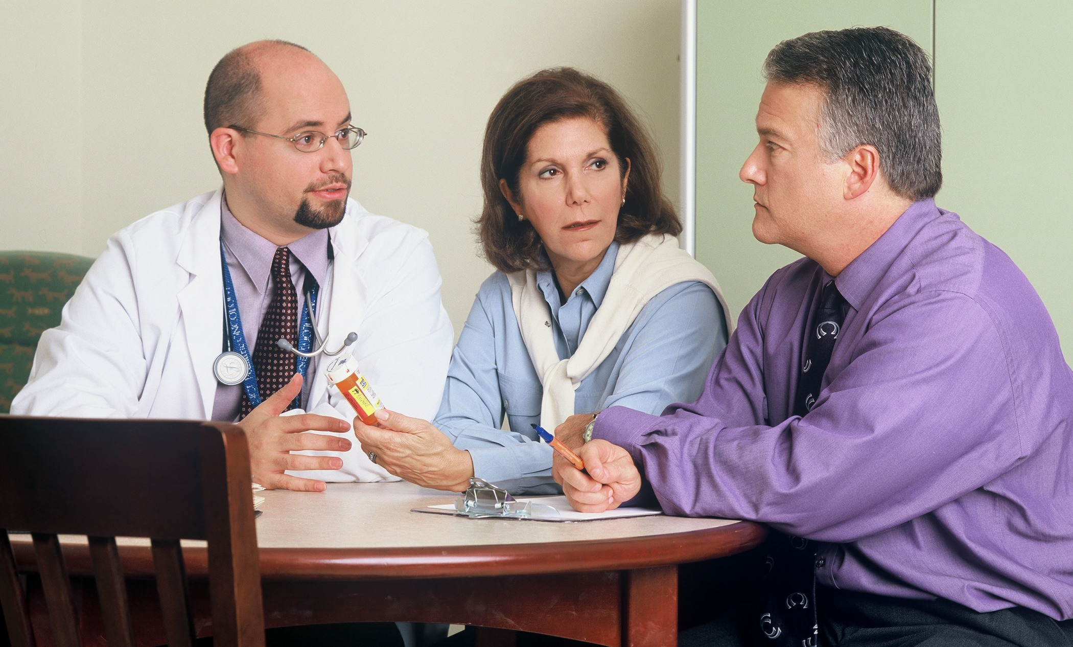 Couple consults with physician to determine treatment strategies