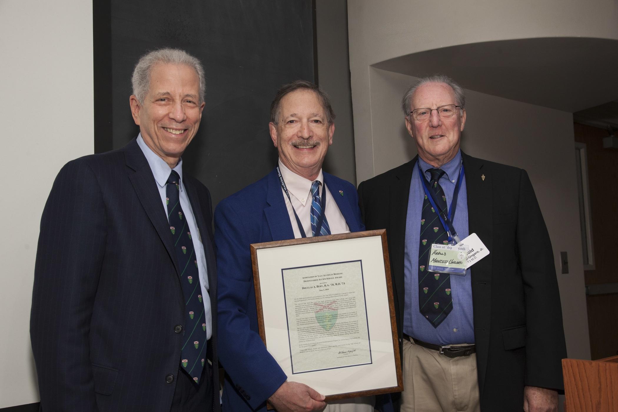 Douglas Berv, B.A. '70, M.D. '74, received the Distinguished Alumni Service Award from Dean Robert Alpern and AYAM President Harold Mancusi-Ungaro, M.D. '73