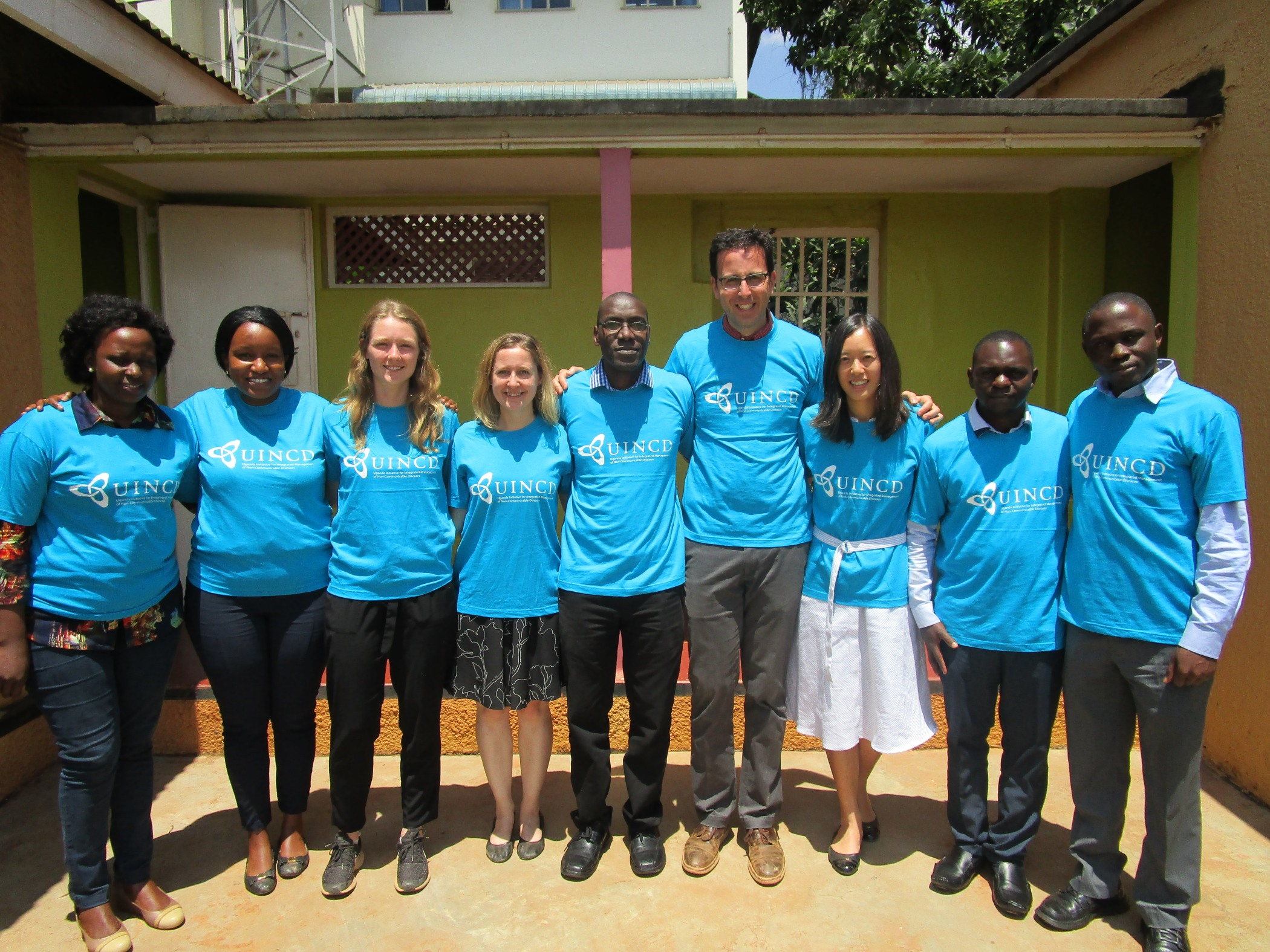 NGN members, fellows, and Ugandan collaborators outside the UINCD office in Kampala.