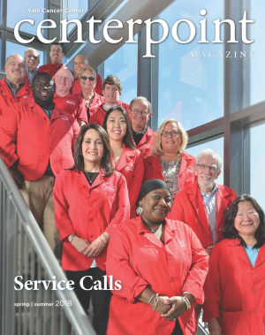 cover of Centerpoint magazine with volunteers in red coats