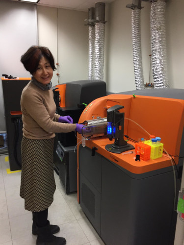 Research associate, Shelly Ren, works with samples in the lab