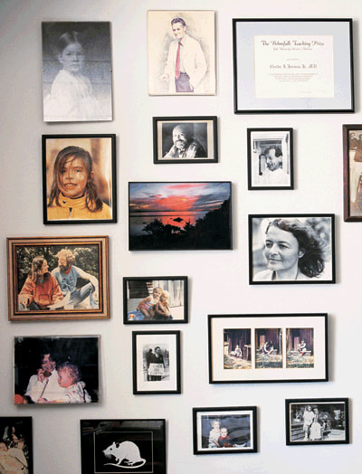 The wall of photographs in Janeway's office tells the story of his personal and professional relationships, many of which are intertwined.