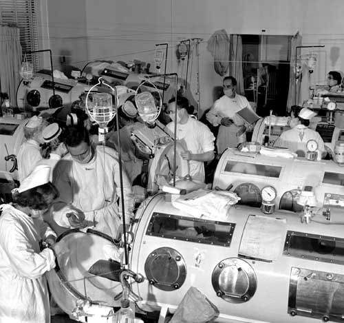 Patients stricken with the most severe form of polio were confined to iron lungs, such as those seen in this ward at Haynes Memorial Hospital in Boston in August 1955.
