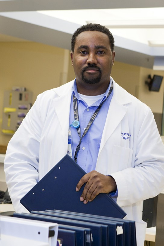 Gregory Johnson, a Health Promotion Advocates, screens patients for alcohol and drug abuse.