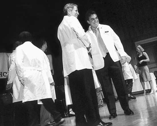 At White Coat Ceremony last August, Dean Robert Alpern greeted first-year David Gimbel.