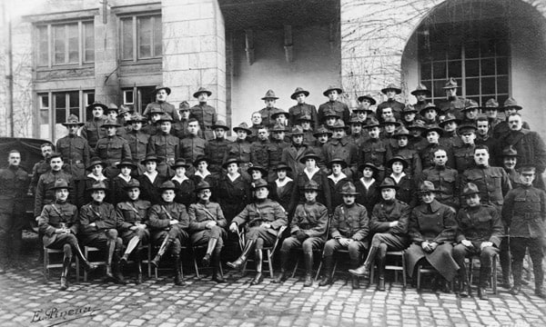 The men and women of the Yale Mobile Operating Unit No. 39. Joseph Marshall Flint is seated in the front row, center.
