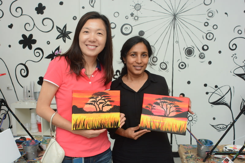Ni La and Roshni Srivastava, researchers in cardiovascular medicine, took a break to paint during their lunch hour in August.