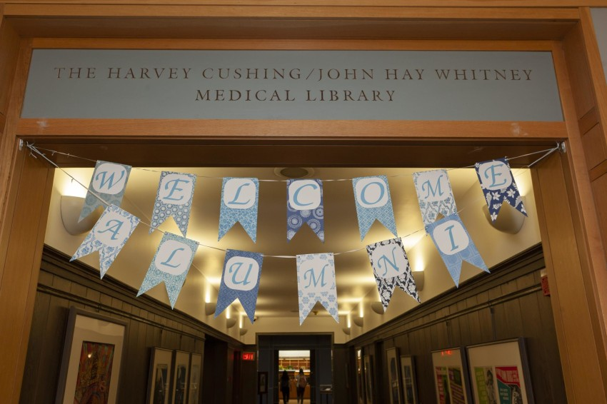 blue and white welcome alumni sign