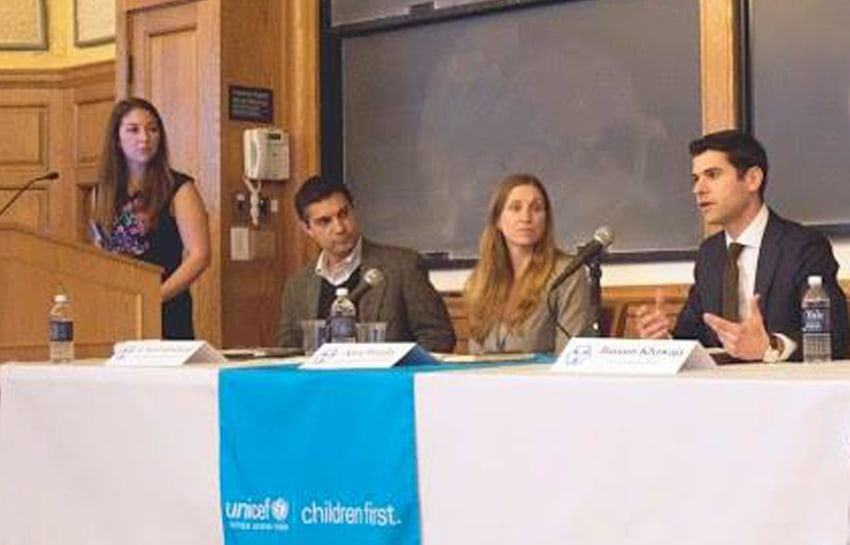 Caroline Tangoren, Conference Coordinator, introduces panelists Kaveh Khoshnood, Katie Murphy, and Bassam Khawaja.
