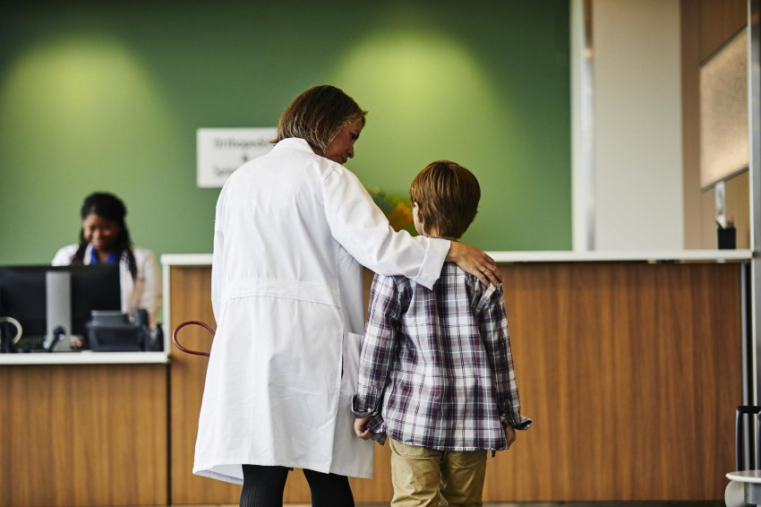 Physician with child patient