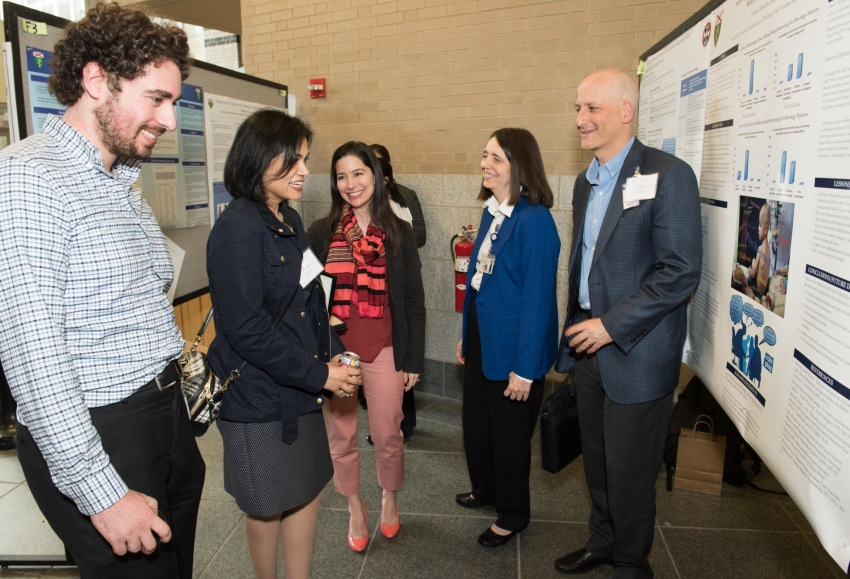 YSM attendees discuss colleagues' poster presentations at Med Ed Day, May 2017; left to right: Emeric Bojarski, MD; Zheala Qayyum, MD; Claudia Moreno, MD; Linda Mayes, MD; Andres Martin, MD, MPH.