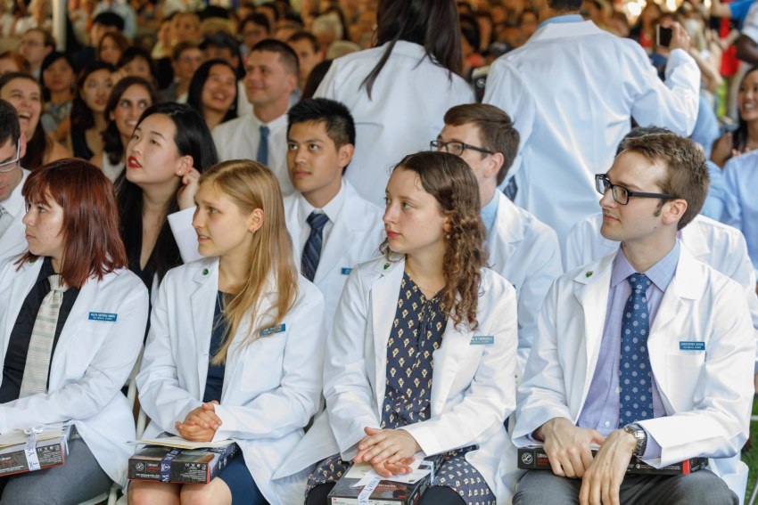 Medical Students sitting at the annual White Coat Ceremony.