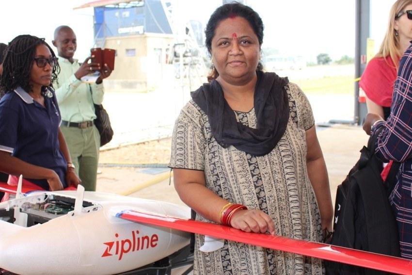 Woman standing next to ZipLine drone in Rwanda during EPI LAMP forum 2