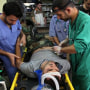 Physicians and medical staff treat patients in a hospital in Aleppo, Syria.