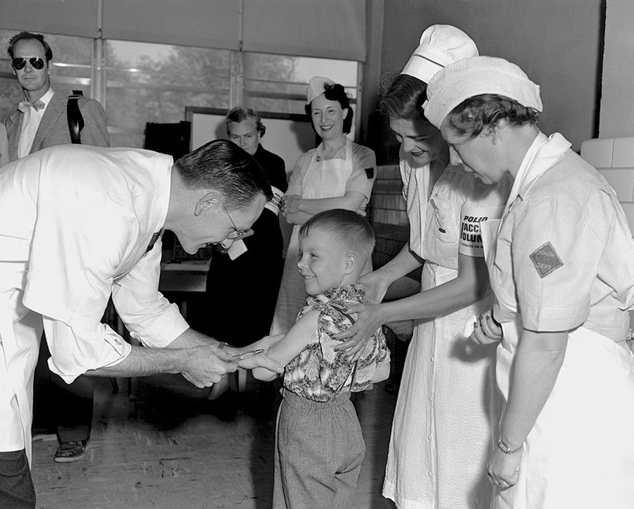 The national trial of the Salk polio vaccine began in 1954, when Richard Mulvaney gave an injection to Randy Kerr at Franklin Sherman Elementary School in McLean, Va.