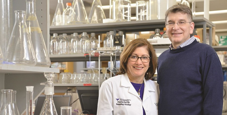 Dr. Francine Foss and Dr. Elias Lolis standing in the lab