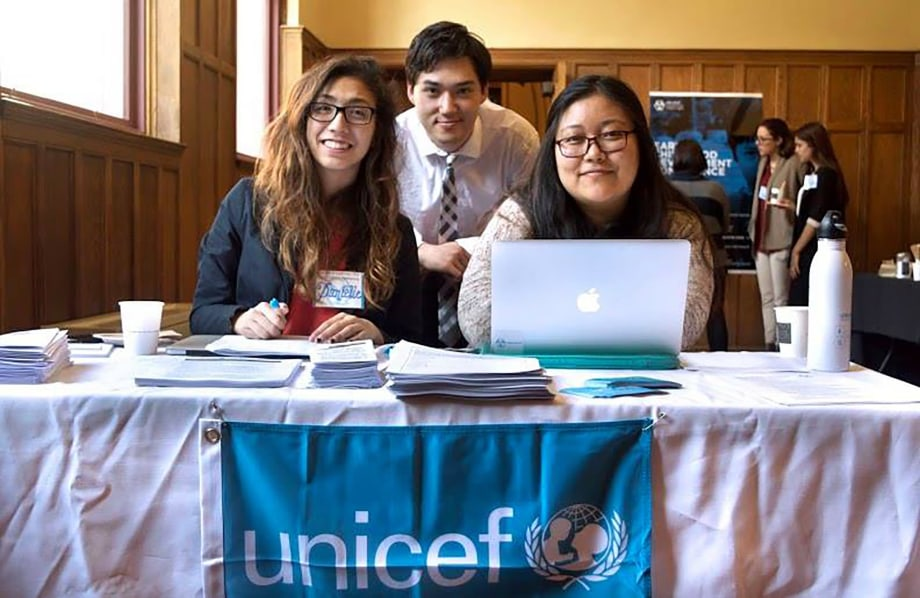 Yale UNICEF students, Dani Stamer, Kai Debus, and Yondeen Sherpa, greet and register their guests