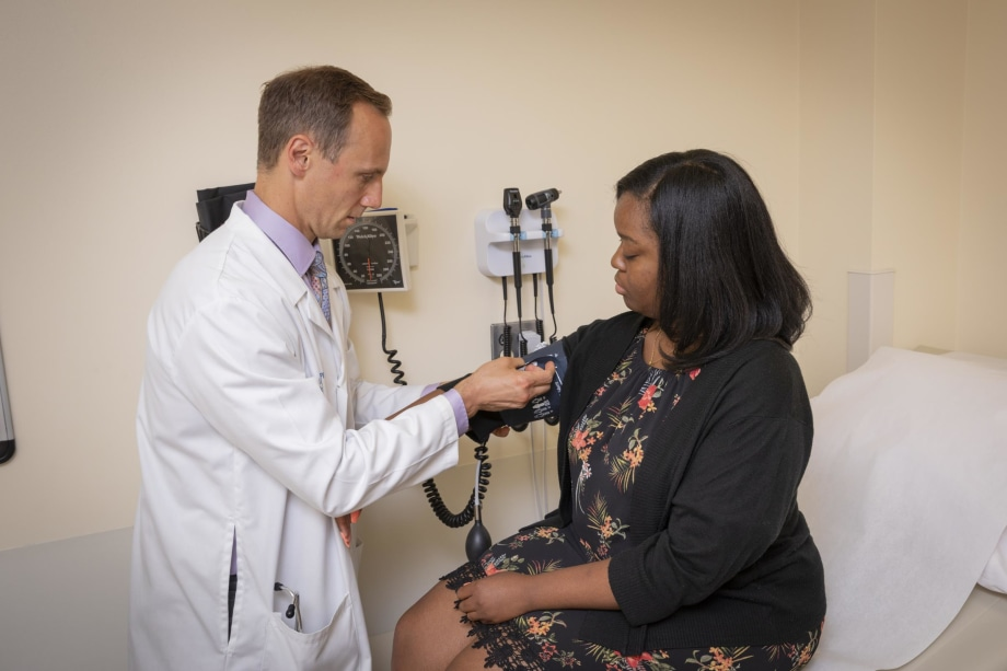 Randy Luciano, MD, PhD, cares for a patient in the Nephrology Clinic at the Yale Physicians Building.