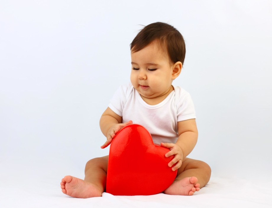 Baby Holding Heart