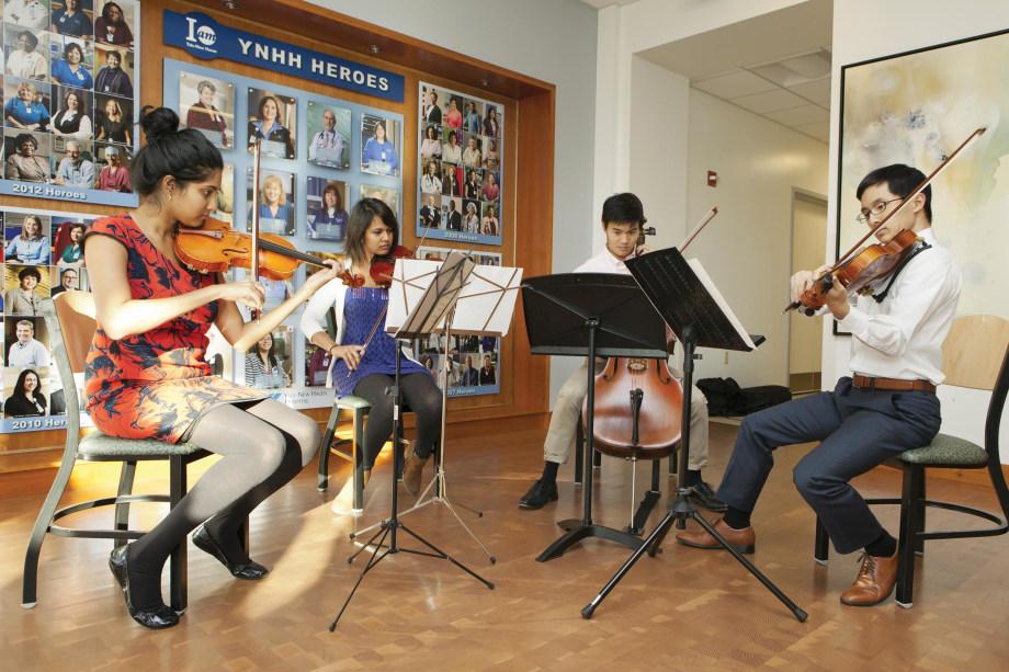 The Cedar Strings Quartet, composed of medical students Aishwarya Vijay, Michelle Ferreira, William Chen, and Charles Hsu