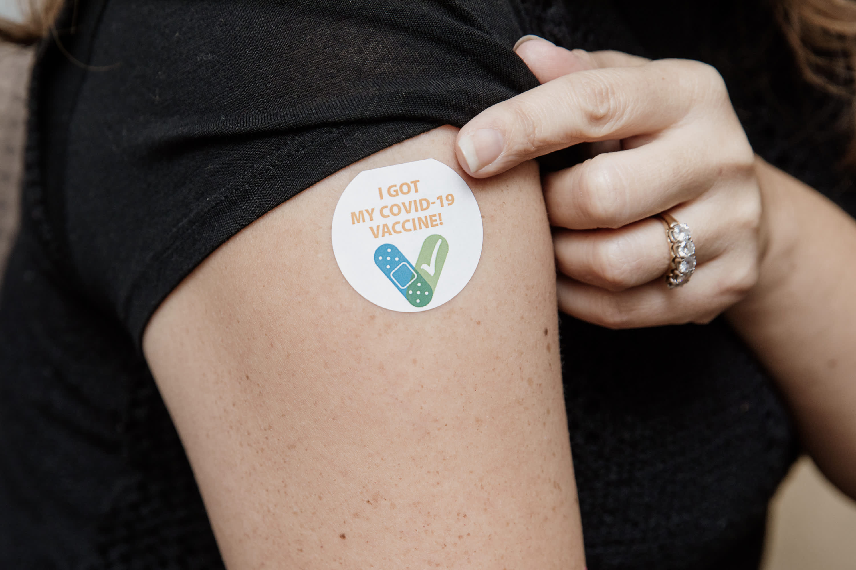 Sandra Trevino, LCSW, with a sticker after having received the COVID-19 vaccine