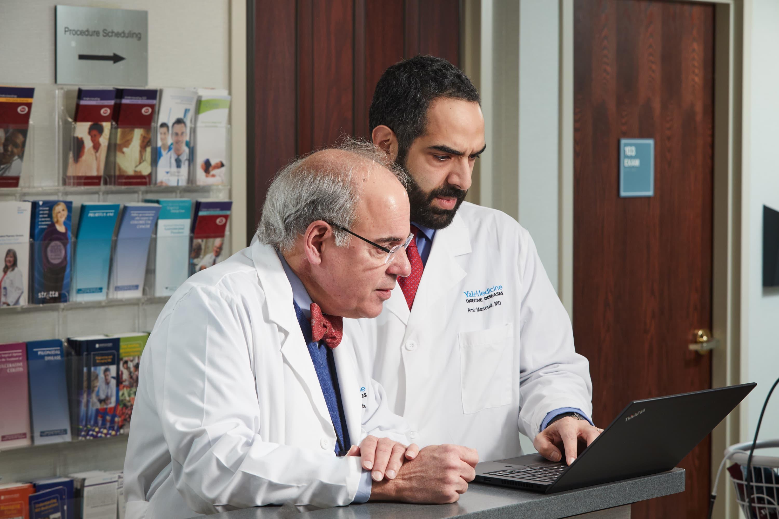 William Ravich, MD, consults with a colleague about a GI case.