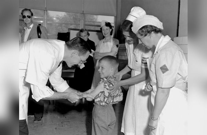 A Young Boy Receives the first of the Polio vaccine
